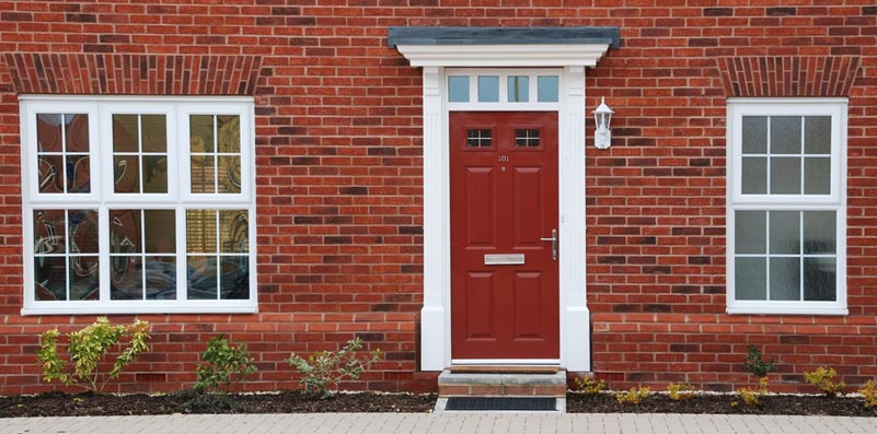 Red front door with white archway